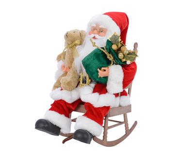 Vánoční dekorace - Santa v houpacím křesle - hrající 26x36 cm, Kaemingk